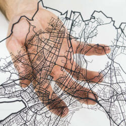 Lasercut street network of zurich in paper by Robin Hanhart