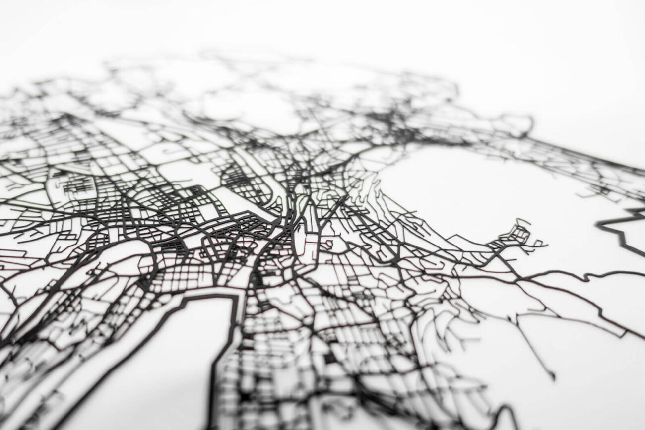 Lasercut street network of zurich in paper - detail