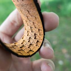 Lasercut bendable wood - Arm bracelet in yellow - View of backside