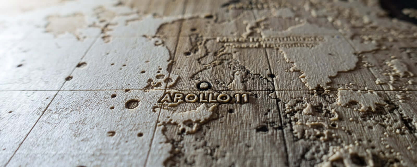 Topographic map of landing site of Apollo 11 on the Moon. Laser engraving in wood.