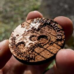 Laser engraved token made from cherry wood. It shows a small section of moon topography.