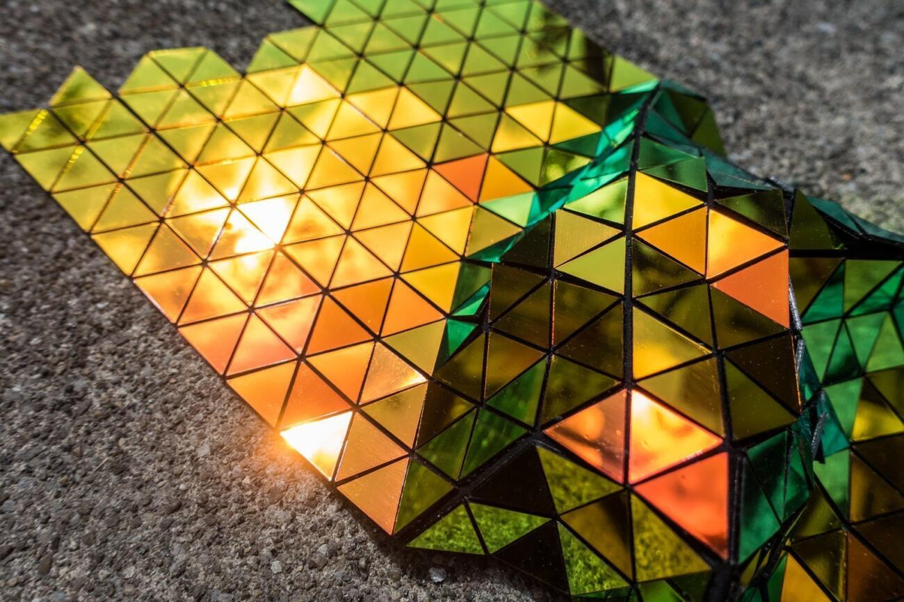 Lasercut geometric textile pattern made with dichroic material by Robin Hanhart