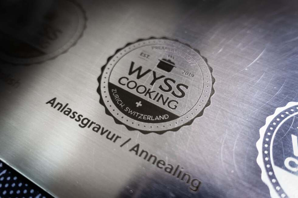 Annealing laser marking of logo-graphic with fiber laser on brushed stainless steel